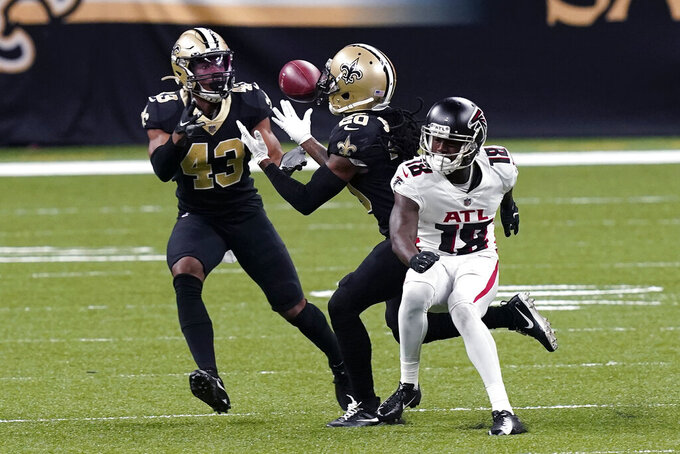 New Orleans Saints cornerback Janoris Jenkins (20) intercepts a pass that was intended for Atlanta Falcons wide receiver Calvin Ridley (18), next to free safety Marcus Williams (43) in the second half of an NFL football game in New Orleans, Sunday, Nov. 22, 2020. (AP Photo/Butch Dill)