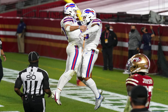 Buffalo Bills wide receiver Gabriel Davis, right, celebrates his touchdown with quarterback Josh Allen (17) during the second half of an NFL football game against the San Francisco 49ers, Monday, Dec. 7, 2020, in Glendale, Ariz. (AP Photo/Ross D. Franklin)