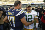 Los Angeles Chargers quarterback Philip Rivers, left, greets Green Bay Packers quarterback Aaron Rodgers after their win in an NFL football game Sunday, Nov. 3, 2019, in Carson, Calif. (AP Photo/Marcio Jose Sanchez)