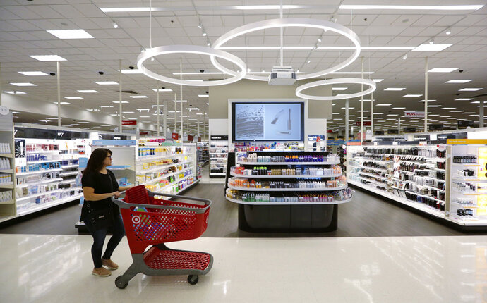 FILE- In this May 30, 2018, file photo, a shopper walks through the updated cosmetic department at a Target store in San Antonio. On Friday, Aug. 10, the Labor Department reports on U.S. consumer prices for July. (AP Photo/Eric Gay, File)