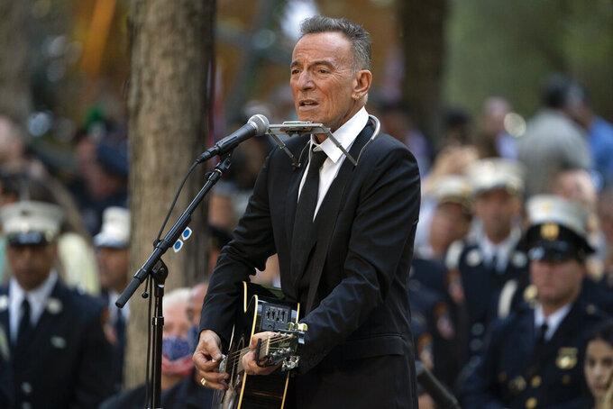 FILE - In this Saturday, Sept. 11, 2021, file photo, Bruce Springsteen performs during ceremonies to commemorate the 20th anniversary of the 9/11 terrorist attacks, at the National September 11 Memorial & Museum in New York. Springsteen's most memorable artifacts including his favorite Fender guitar and stage outfits will be on display in a traveling interactive exhibit. The Grammy Museum announced Tuesday, Sept. 14, 2021, that Bruce Springsteen Live! will open at the Grammy Museum Experience in the Prudential Center in Newark, New Jersey, on Oct. 1. (AP Photo/John Minchillo, File)