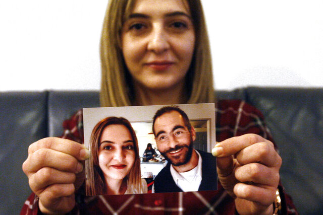 FILE - In this July 30, 2019, file photo, Aya Al-Umari, whose brother Hussein was killed in the Christchurch mosque attacks, poses, holding a photo of herself and her brother, in Christchurch, New Zealand. Al-Umari is one of more than 60 survivors and family members who this week in court will confront the white supremacist who committed the worst atrocity in New Zealand's modern history, when he slaughtered 51 worshippers at two Christchurch mosques in March 2019. The four-day sentencing starts on Monday, Aug. 24, 2020.(AP Photo/Nick Perry, File)