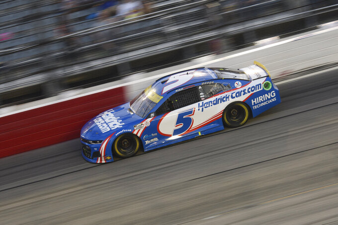 Kyle Larson races in a NASCAR Cup Series auto race Sunday, Sept. 5, 2021, in Darlington, S.C. (AP Photo/John Amis)