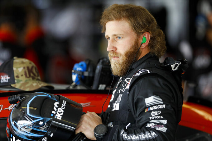 Jeffrey Earnhardt looks out from his garage stall before a practice session for Saturday's NASCAR Xfinity Series auto race at Pocono Raceway, Friday, May 31, 2019, in Long Pond, Pa. (AP Photo/Matt Slocum)