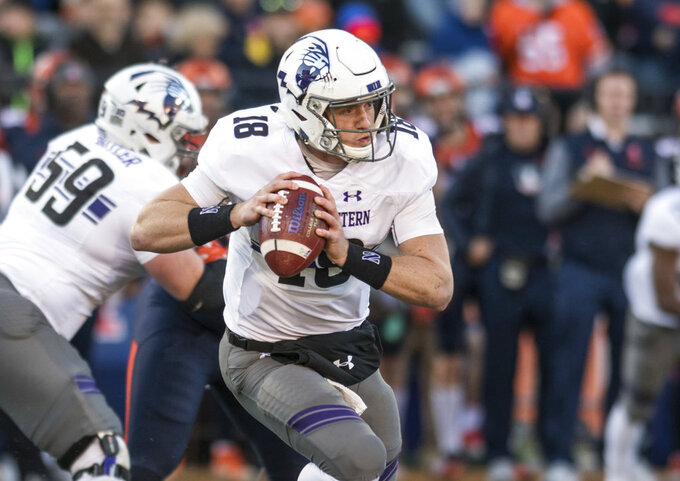 FILE - In this Nov. 25, 2017, file photo, Northwestern quarterback Clayton Thorson (18) looks for a receiver during the first half of the team's NCAA college football game against Illinois in Champaign, Ill. Thorson hopes to play in the opener at Purdue after last season ended with him getting carted off the field with a torn anterior cruciate ligament in his right knee. (AP Photo/Bradley Leeb, File)