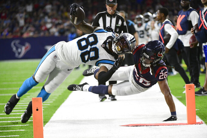 Carolina Panthers wide receiver Terrace Marshall Jr. (88) is knocked out of bounds by Houston Texans cornerback Vernon Hargreaves III (26) during the second half of an NFL football game Thursday, Sept. 23, 2021, in Houston. (AP Photo/Justin Rex)