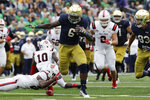 FILE - In this Sept. 8, 2018, file photo, Notre Dame running back Tony Jones Jr (6), runs in a touchdown against Ball State during the first half of an NCAA college football game in South Bend, Ind. There is no Dexter Williams in the backfield this season for No. 9 Notre Dame. Instead, the Fighting Irish will look to a stable of running backs to pick up the slack, including Tony Jones and converted wide receiver Jafar Armstrong. (AP Photo/Nam Y. Huh, File)