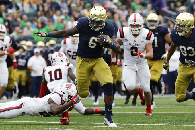 No. 9 Notre Dame visits rebuilding Louisville on Labor Day
