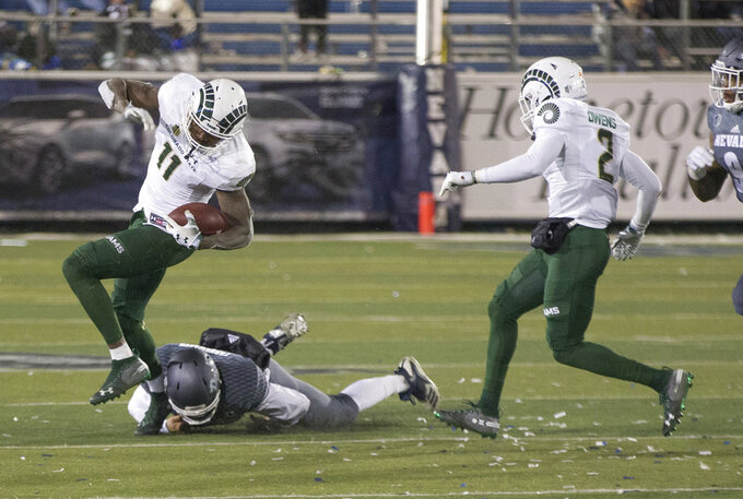 Colorado State wide receiver Preston Williams (11) is hit by Nevada's Daiyan Henley in the second half of an NCAA college football game in Reno, Nev., Saturday, Nov. 10, 2018. (AP Photo/Tom R. Smedes)