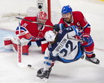 Montreal Canadiens' Shea Weber (6) knocks down Winnipeg Jets' Mason Appleton (22) in front of Canadiens goalie Carey Price (31) during the third period of an NHL Stanley Cup playoff hockey game in Montreal, Sunday, June 6, 2021.  (Paul Chiasson/The Canadian Press via AP)