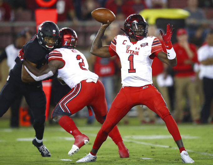 Utah quarterback Tyler Huntley (1) throws a pass against Stanford during the first half of an NCAA college football game Saturday, Oct. 6, 2018, in Stanford, Calif. (AP Photo/Ben Margot)