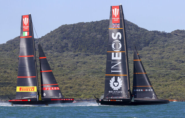 Ineos Team UK, right, leads Italy's Luna Rossa during the Prada Cup challengers series on Auckland's Waitemate Harbour, New Zealand, Friday, Jan. 15, 2021. The winner of the five week long Challenger Series goes on to challenge defenders Team New Zealand for the America's Cup from March 6 to 15. (Brett Phibbs/NZ Herald via AP)