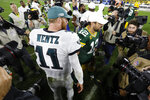 Philadelphia Eagles quarterback Carson Wentz (11) and Green Bay Packers quarterback Aaron Rodgers (12) greet each other on the field following an NFL football game Thursday, Sept. 26, 2019, in Green Bay, Wis. Philadelphia won 34-27. (AP Photo/Mike Roemer)