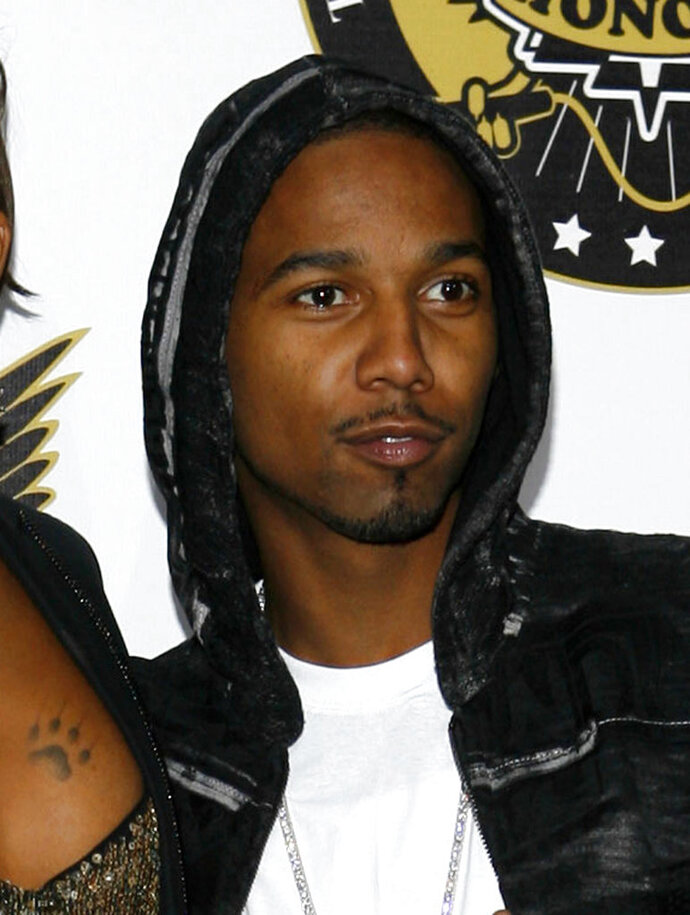 FILE - In this Oct. 2, 2008 file photo, Juelz Santana arrives at the VH1 Hip Hop Honors in New York.  Santana's scheduled trial on charges he tried to get a gun onto a plane at Newark Liberty International Airport has been pushed back so the rapper can continue negotiations for a plea deal. A trial had been scheduled for early September 2018. But an order filed this month extends the trial date at least until September 30. (AP Photo/Jason DeCrow, File)