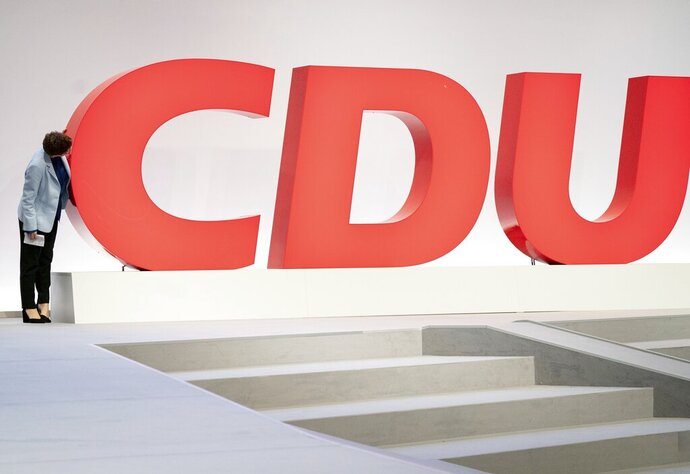 Annegret Kramp-Karrenbauer the Federal Minister of Defense and CDU Federal Chairman of the centre-right  Christian Democratic Union party (CDU), checks the staging before the CDU Federal Party Congress event in Leipzig, Germany, Thursday Nov. 21, 2019. The congress will be held from 22 to 23 November. (Kay Nietfeld / dpa via AP)