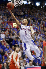 FILE - In this Feb. 1, 2020, file photo, Kansas guard Devon Dotson (1) makes a layup during the first half of an NCAA college basketball game against Texas Tech,  in Lawrence, Kan. Dotson was selected to the Associated Press All-Big 12 first team announced Tuesday, March 10, 2020. (AP Photo/Orlin Wagner, File)