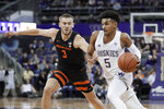 Washington guard Jamal Bey (5) drives around Oregon State forward Tres Tinkle (3) during the first half of an NCAA college basketball game Thursday, Jan. 16, 2020, in Seattle. (AP Photo/Ted S. Warren)