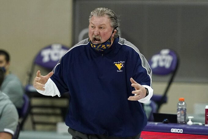 FILE - West Virginia head coach Bob Huggins shouts at an official during the second half of an NCAA college basketball game against TCU in Fort Worth, Texas, in this Tuesday, Feb. 23, 2021. Huggins enters his 40th season as a head coach with 900 career wins and a new two-year contract extension. (AP Photo/Tony Gutierrez, File)