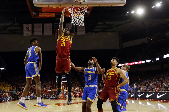 Southern California forward Onyeka Okongwu (21) dunks against UCLA during the second half of an NCAA college basketball game Saturday, March 7, 2020, in Los Angeles. (AP Photo/Marcio Jose Sanchez)