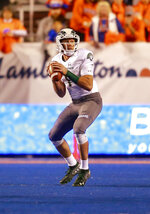 Colorado State quarterback K.J. Carta-Samuels (1) looks downfield against Boise State in the first half of an NCAA college football game, Friday, Oct. 19, 2018, in Boise, Idaho. (AP Photo/Steve Conner)