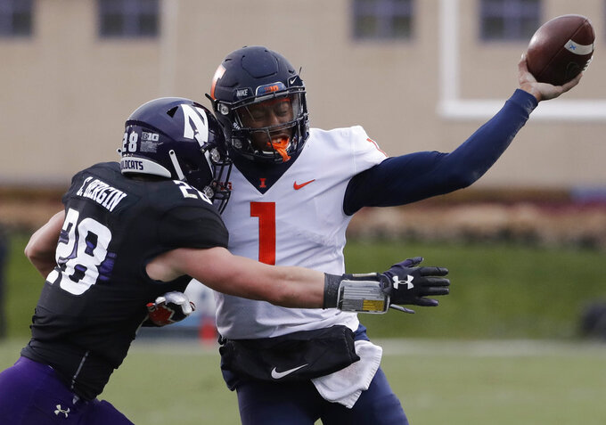 Illinois quarterback AJ Bush Jr., right, is tackled by Northwestern linebacker Chris Bergin during the first half of an NCAA college football game in Evanston, Ill., Saturday, Nov. 24, 2018. (AP Photo/Nam Y. Huh)