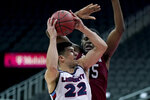 Liberty's Kyle Rode (22) shoots under pressure from South Carolina's Wildens Leveque, back, during the second half of an NCAA college basketball game Saturday, Nov. 28, 2020, at the T-Mobile Center in Kansas City, Mo. (AP Photo/Charlie Riedel)
