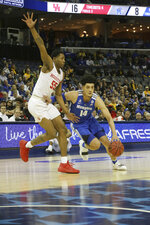 Memphis player Isaiah Maurice drives the ball past Houston's Brinson Gresham in the first half of an NCAA college basketball game at the American Athletic Conference tournament Saturday, March 16, 2019, in Memphis, Tenn. (AP Photo/Troy Glasgow)