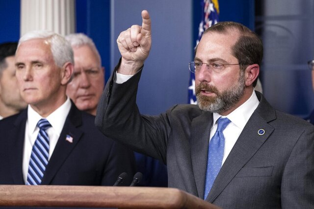 Health and Human Services Secretary Alex Azar speaks, with Vice President Mike Pence behind him, during a briefing about the coronavirus in the James Brady Press Briefing Room of the White House, Sunday, March 15, 2020, in Washington. (AP Photo/Alex Brandon)