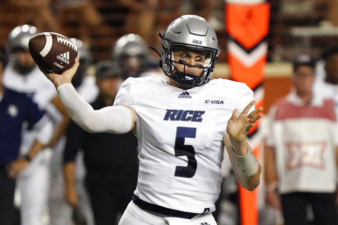 Rice quarterback Wiley Green (5) looks to pass against Texas during the first half of an NCAA college football game on Saturday, Sept. 18, 2021, in Austin, Texas. (AP Photo/Chuck Burton)
