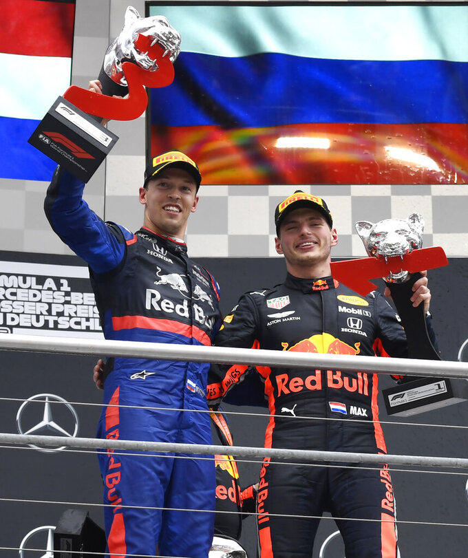 Red Bull driver Max Verstappen of the Netherland's, right, winner, is flanked by second place Toro Rosso driver Daniil Kvyat of Russia on the podium after the German Formula One Grand Prix at the Hockenheimring racetrack in Hockenheim, Germany, Sunday, July 28, 2019. (AP Photo/Jens Meyer)