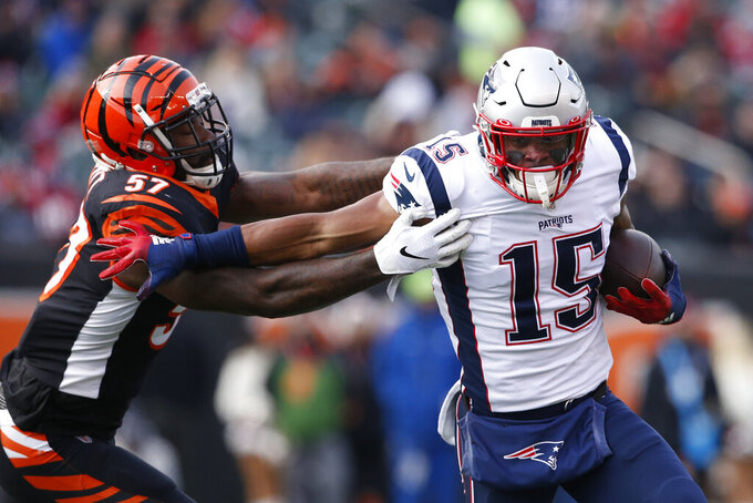 New England Patriots wide receiver N'Keal Harry (15) runs the ball against Cincinnati Bengals linebacker Germaine Pratt (57) in the first half of an NFL football game, Sunday, Dec. 15, 2019, in Cincinnati. (AP Photo/Gary Landers)