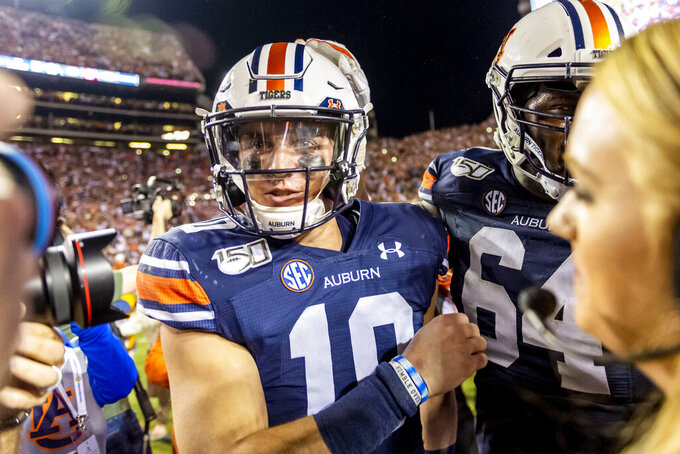 Auburn quarterback Bo Nix (10) celebrates after a win over Alabama in an NCAA college football game, Saturday, Nov. 30, 2019, in Auburn, Ala. (AP Photo/Vasha Hunt)