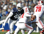 Penn State's Shareef Miller (48) moves in to sack Wisconsin quarterback Jack Coan (17) during the first half of an NCAA college football game in State College, Pa., Saturday, Nov. 10, 2018. (AP Photo/Chris Knight)