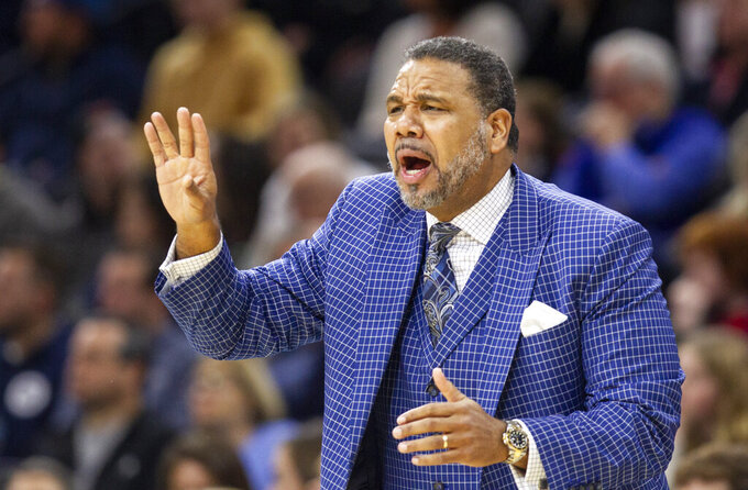 Providence head coach Ed Cooley shouts from the sideline during the first half of an NCAA college basketball game against Villanova, Saturday, Feb. 29, 2020, in Philadelphia, Pa. (AP Photo/Laurence Kesterson)