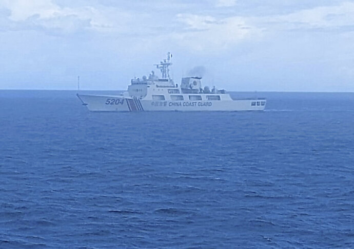 This undated photo released on Tuesday, Sept. 15, 2020, by Indonesian Maritime Security Agency (BAKAMLA) shows a Chinese Cost Guard ship sails in North Natuna Sea. An Indonesian patrol ship confronted the Chinese vessel that spent almost three days in waters where Indonesia claims economic rights and that are near the southernmost part of China's disputed South China Sea claims. (Indonesian Maritime Security Agency via AP)