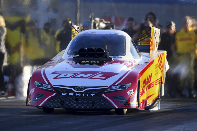 In this photo provided by the NHRA, J.R. Todd drives in Funny Car qualifying Friday, Nov. 1, 2019, at the Dodge NHRA Nationals in Las Vegas. Todd had a run of 3.856 seconds at 333.58 mph. (Marc Gewertz/NHRA via AP)