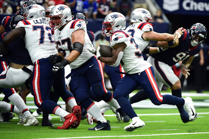 New England Patriots running back Damien Harris (37) rushes for a touchdown against the Houston Texans during the first half of an NFL football game Sunday, Oct. 10, 2021, in Houston. (AP Photo/Justin Rex)