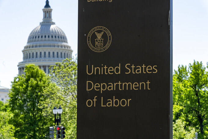 FILE - In this May 7, 2020, file photo, the entrance to the Labor Department is seen near the Capitol in Washington. Unemployment fraud in the U.S. has reached dramatic levels during the pandemic: more than $63 billion has been paid out improperly through fraud or errors since March 2020. Criminals are seizing on the opportunity created by the pandemic and are making false claims using stolen information. (AP Photo/J. Scott Applewhite, File)