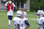 New England Patriots quarterback Cam Newton (1) works out with teammates during an NFL football training camp practice, Thursday Aug. 27, 2020 in Foxborough, Mass. (AP Photo/Steven Senne, Pool)