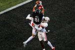 Cincinnati tight end Josh Whyle (81) makes a catch for a touchdown against Houston safety Gervarrius Owens during the first half of an NCAA college football game, Saturday, Nov. 7, 2020, in Cincinnati. (AP Photo/Aaron Doster)