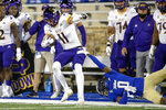 East Carolina wide receiver Blake Proehl (11) secures a catch while being forced out of bounds by Tulsa cornerback Tyon Davis (0) during an NCAA college football game Friday, Oct. 30, 2020, in Tulsa, Okla. (Ian Maule/Tulsa World via AP)