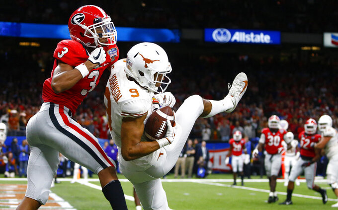 Texas wide receiver Collin Johnson (9) pulls in a 2-point conversion against Georgia defensive back Tyson Campbell (3) during the second half of the Sugar Bowl NCAA college football game in New Orleans, Tuesday, Jan. 1, 2019. (AP Photo/Butch Dill)