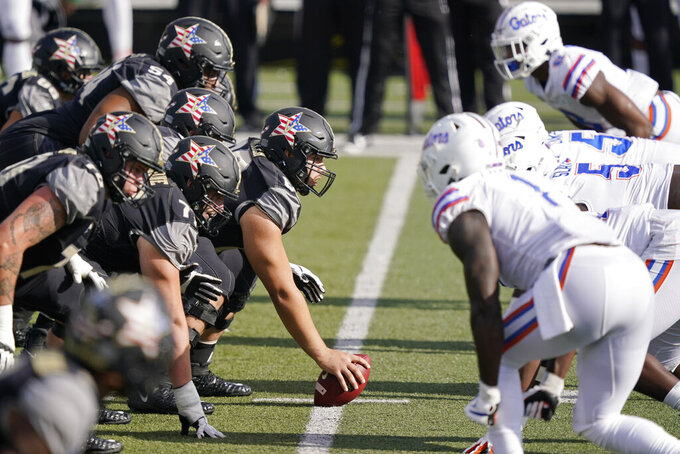 Vanderbilt lines up against Florida in the second half of an NCAA college football game Saturday, Nov. 21, 2020, in Nashville, Tenn. (AP Photo/Mark Humphrey)