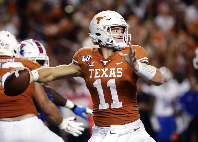 Texas quarterback Sam Ehlinger (11) throws against Louisiana Tech during the second half of an NCAA college football game, Saturday, Aug. 31, 2019, in Austin, Texas. (AP Photo/Eric Gay)