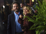 Zach Galifianakis, left, and Kaley Cuoco arrive at the Los Angeles premiere of
