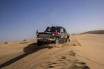 In this Monday, Jan. 13, 2020 photo, driver Quan Ruan, of China, and co-driver Yirong Wang, of China, race their Chevrolet during stage eight of the Dakar Rally in Wadi Al Dawasir, Saudi Arabia. Formerly known as the Paris-Dakar Rally, the race was created by Thierry Sabine after he got lost in the Libyan desert in 1977. Until 2008, the rallies raced across Africa, but threats in Mauritania led organizers to cancel that year's event and move it to South America. It has now shifted to Saudi Arabia. The race started on Jan. 5 with 560 drivers and co-drivers, some on motorbikes, others in cars or in trucks. Only 41 are taking part in the Original category. (AP Photo/Bernat Armangue)