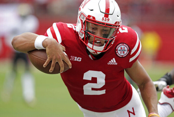 FILE - In this Saturday, Sept. 8, 2018, file photo, Nebraska quarterback Adrian Martinez (2) leaps for a touchdown against Colorado during the first half of an NCAA college football game in Lincoln, Neb. Four starts into his career, Martinez already is showing signs of blossoming into the next standout quarterback coached by Scott Frost.  (AP Photo/Nati Harnik, File)