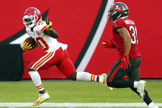 Kansas City Chiefs wide receiver Tyreek Hill (10) reacts as he beats Tampa Bay Buccaneers strong safety Antoine Winfield Jr. (31) on a 75-yard touchown reception during the first half of an NFL football game Sunday, Nov. 29, 2020, in Tampa, Fla. (AP Photo/Mark LoMoglio)