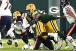 Chicago Bears' Mitchell Trubisky fumbles the ball during the first half of an NFL football game against the Green Bay Packers Sunday, Nov. 29, 2020, in Green Bay, Wis. Preston Smith recovered and returned the fumble for a touchdown. (AP Photo/Morry Gash)