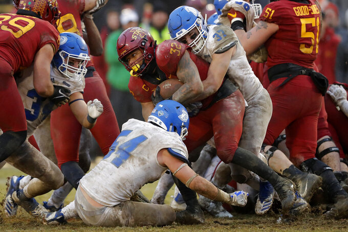 Iowa State running back David Montgomery (32) is tackled by Drake defenders Zac Rujawitz (54) and Connor Willis (37) during the second half of an NCAA college football game, Saturday, Dec. 1, 2018, in Ames, Iowa. Iowa State won 27-24. (AP Photo/Charlie Neibergall)